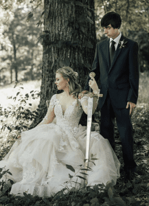 newlywed couple with sword
