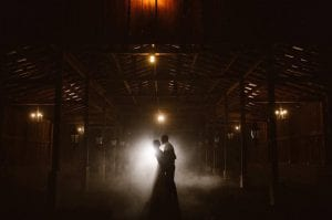 couple silhouette in barn