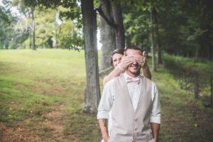 bride covering groom's eyes