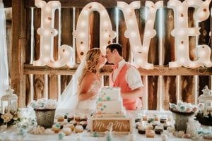 newlywed kiss at reception