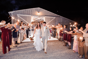 newlyweds exiting with sparklers